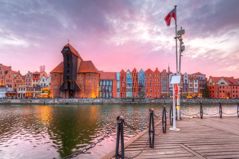 Beautiful port crane and the old town of Gdansk at sunset, Poland. River, motlawa, city, water, europe, travel, architecture, building, reflection, tourism stock image