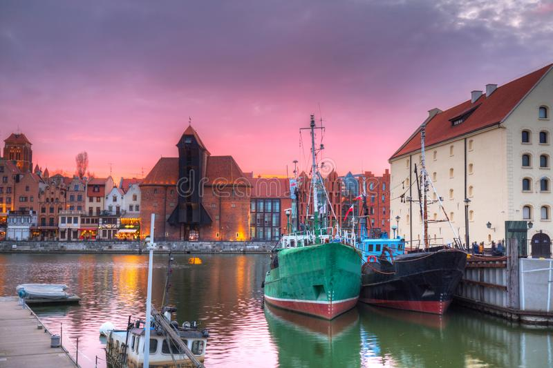 Beautiful port crane and the old town of Gdansk at sunset, Poland. River, motlawa, city, water, europe, travel, architecture, building, reflection, tourism stock photos