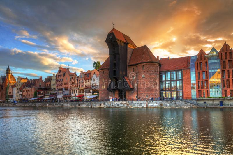 Beautiful port crane and the old town of Gdansk at sunset, Poland. River, motlawa, city, water, europe, travel, architecture, building, reflection, tourism stock photography