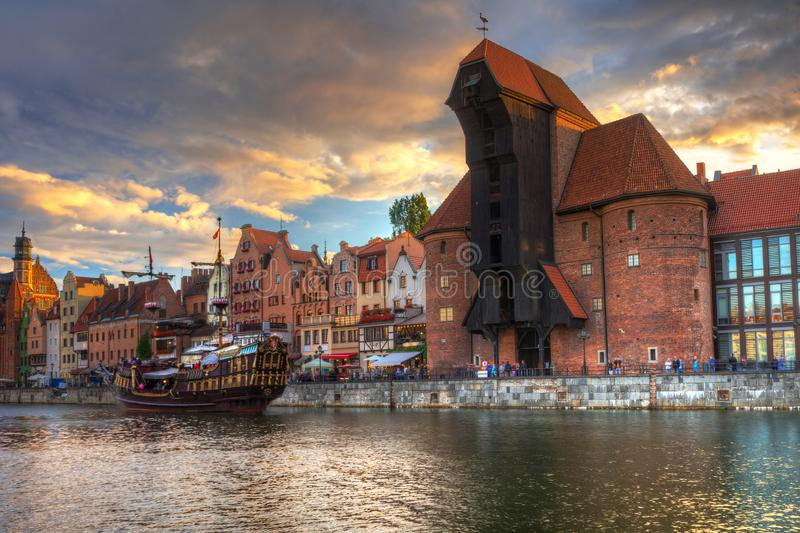 Beautiful port crane and the old town of Gdansk at sunset, Poland. River, motlawa, city, water, europe, travel, architecture, building, reflection, tourism royalty free stock images