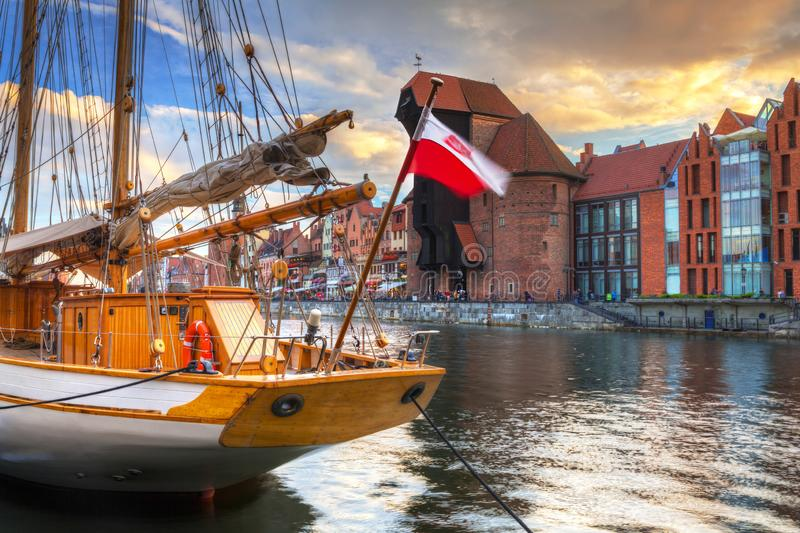 Beautiful port crane and the old town of Gdansk at sunset, Poland. River, motlawa, city, water, europe, travel, architecture, building, reflection, tourism stock photo