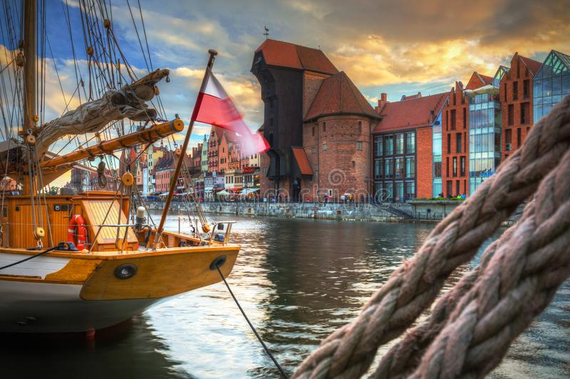 Beautiful port crane and the old town of Gdansk at sunset, Poland. River, motlawa, city, water, europe, travel, architecture, building, reflection, tourism royalty free stock photography