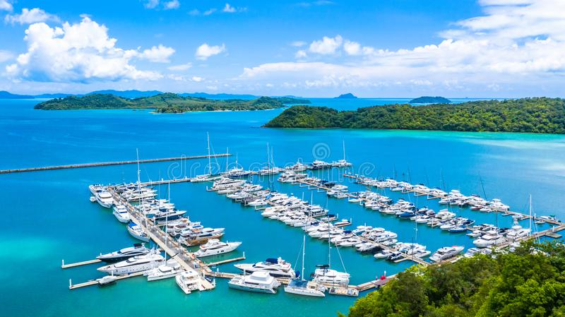Beautiful port yachts and boats in marina bay, Aerial view of yachts and boat in the marina clear water with blue sky background.  royalty free stock photo