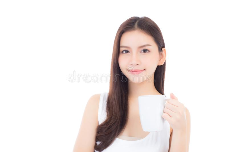 Beautiful portrait asian young woman smiling and drinking water glass with fresh and pure for diet. Beauty girl thirsty and charming holding beverage with stock photography