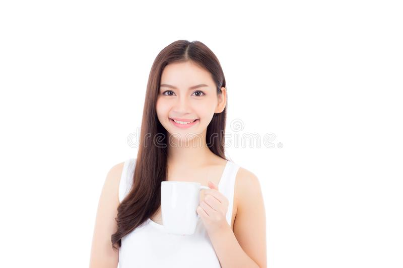 Beautiful portrait asian young woman smiling and drinking water. Glass with fresh and pure for diet, beauty girl thirsty and charming holding beverage with royalty free stock photo