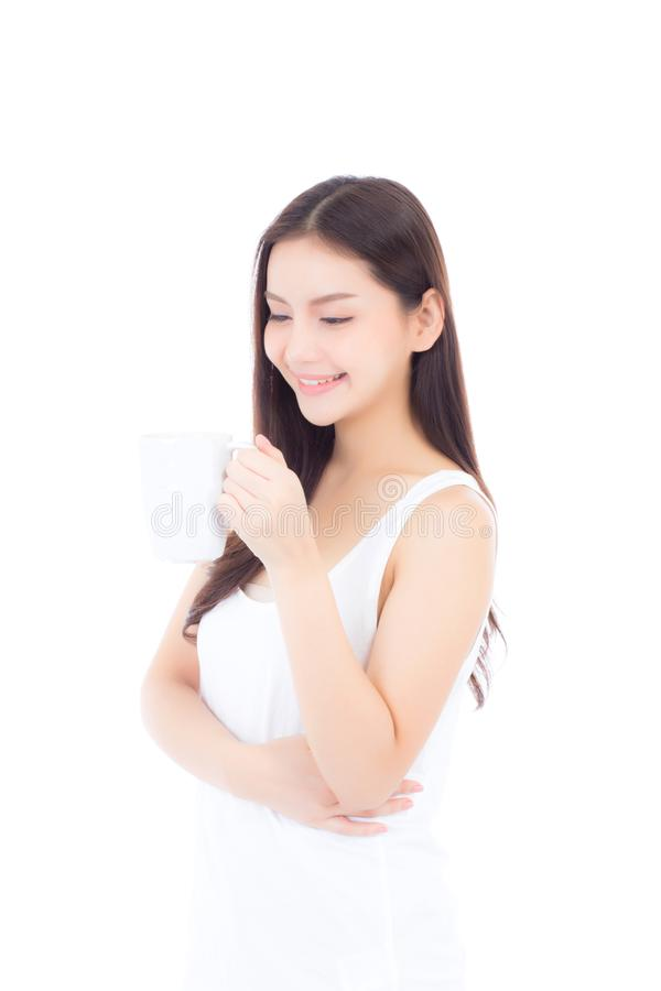 Beautiful portrait asian young woman smiling and drinking water glass with fresh and pure for diet royalty free stock photos