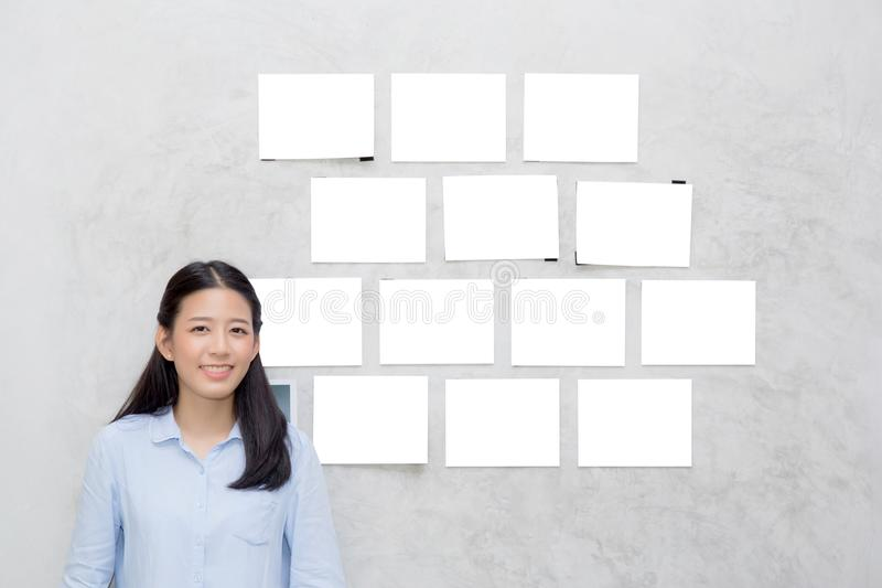 Beautiful of portrait asian young woman standing with picture gallery copy space on wal royalty free stock photography