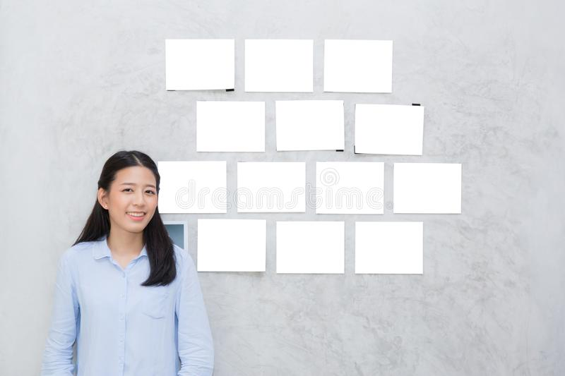 Beautiful of portrait asian young woman standing with picture gallery copy space stock images