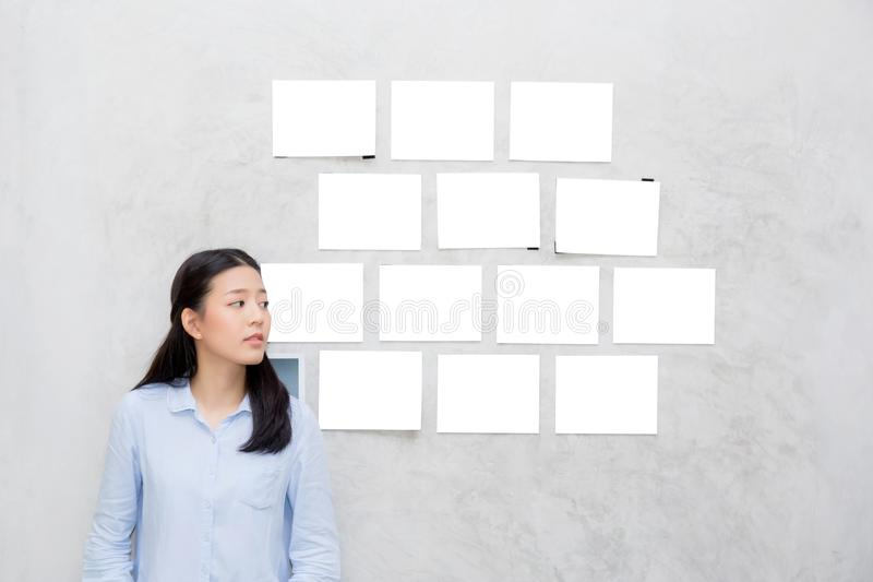 Beautiful of portrait asian young woman standing with picture gallery copy space royalty free stock images
