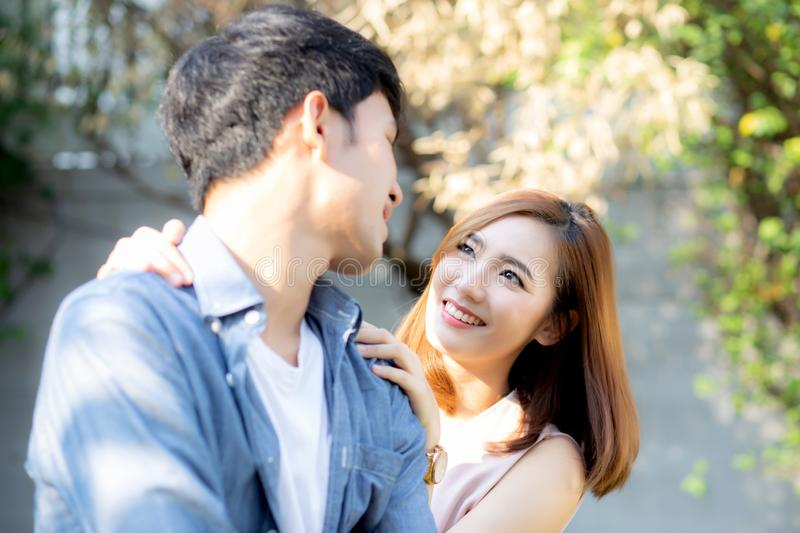Beautiful portrait couple looking each others eyes and smiling with happy stock photo