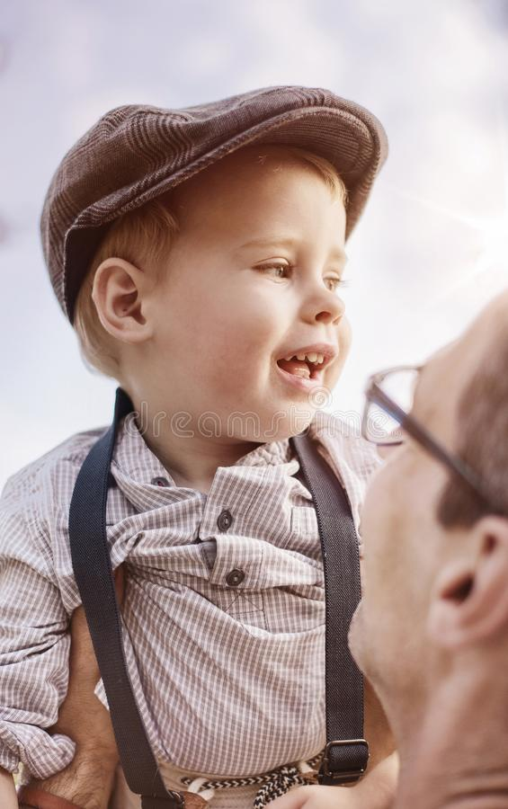 Beautiful portrait of a cute little boy hugging his dad stock image