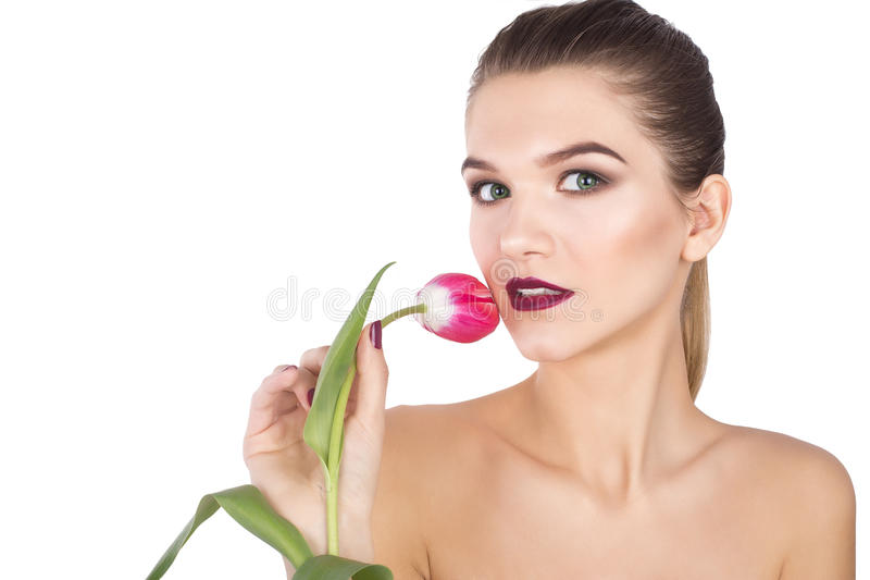 Beautiful portrait of girl with a tulip flower royalty free stock photo