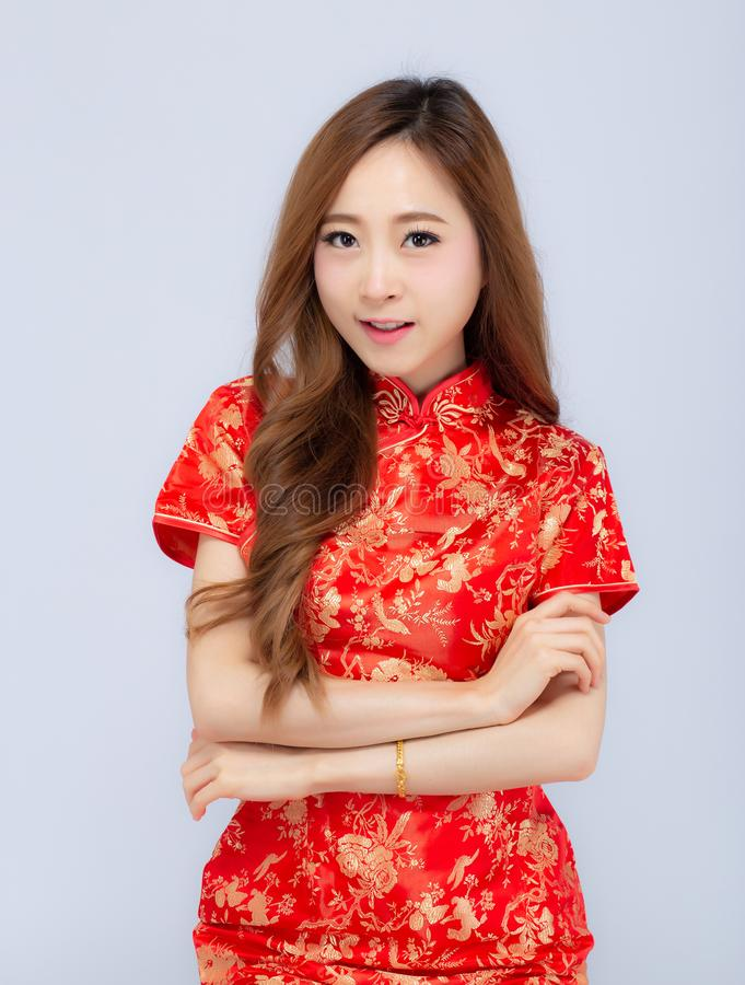 Beautiful portrait happy Chinese New Year young asian woman wear cheongsam smile with gesture congratulation and greeting isolated. On white background royalty free stock photos