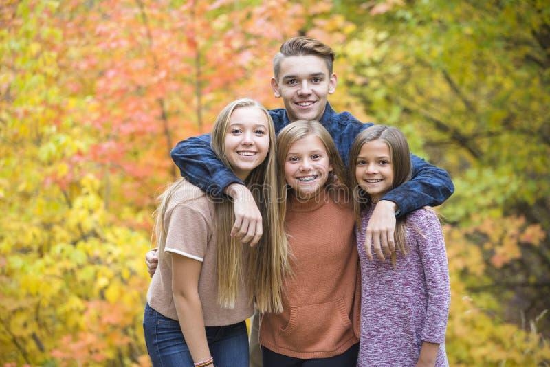 Beautiful Portrait of smiling happy teen kids outdoors stock photos