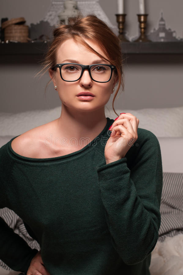 Beautiful portrait of woman, with daily fresh make up and hairstyle, in the glasses royalty free stock photography