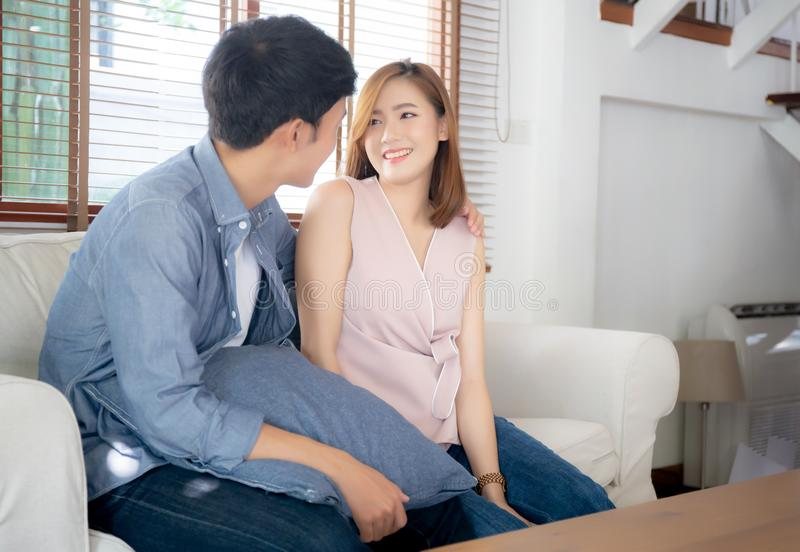 Beautiful portrait young asian couple relax and satisfied together in living room at home royalty free stock photos