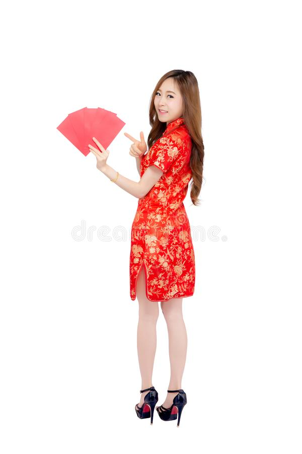 Beautiful portrait young asian woman cheongsam dress smiling pointing holding red envelope on white background. Girl celebrate with exciting, happy Chinese New stock images