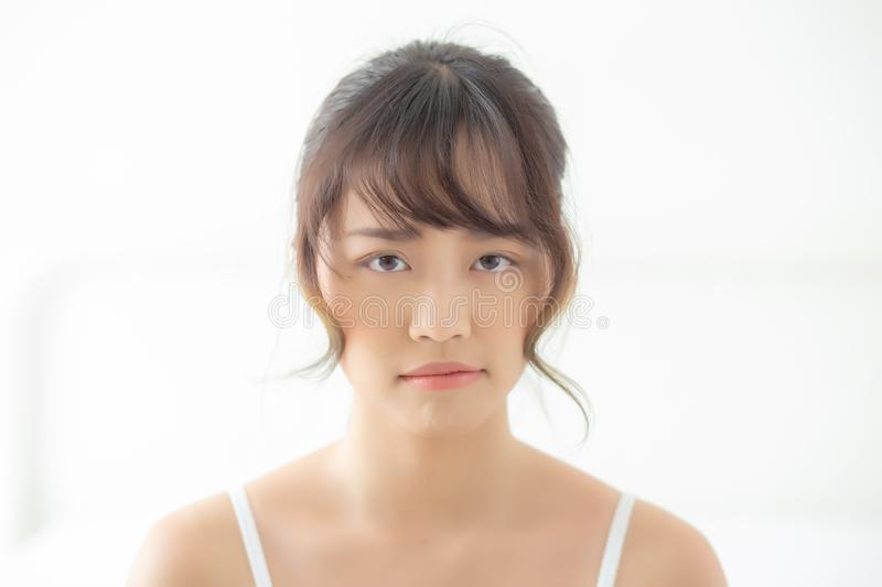 Beautiful portrait young asian woman having worry unhappy and upset about problem skin stock photo