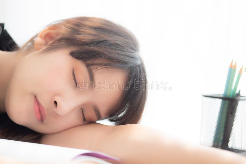 Beautiful portrait young asian woman learning exam or homework and sleep with tired and stress. Lifestyle beauty asia girl having fatigue with work, education royalty free stock photos