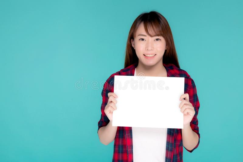 Beautiful portrait young asian woman presenting with blank paper sheet, beauty asia girl wear travel summer fashion royalty free stock photography