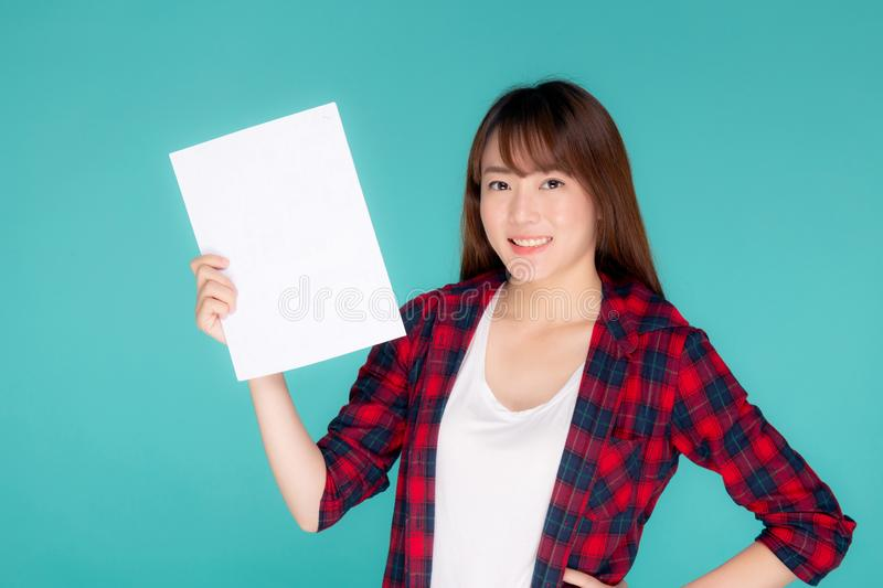 Beautiful portrait young asian woman presenting with blank paper sheet, beauty asia girl wear travel summer fashion. With happy showing empty board or card stock photo