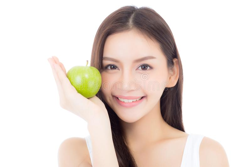 Beautiful of portrait young asian woman smile and holding green apple fruit with heart shape. Beautiful of portrait young asian woman smile and holding green stock photo