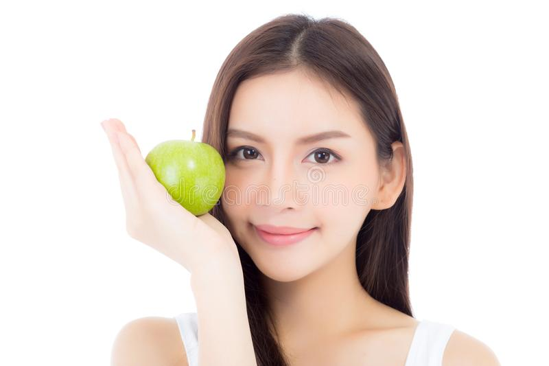 Beautiful of portrait young asian woman smile and holding green apple fruit with heart shape. Beautiful of portrait young asian woman smile and holding green stock images