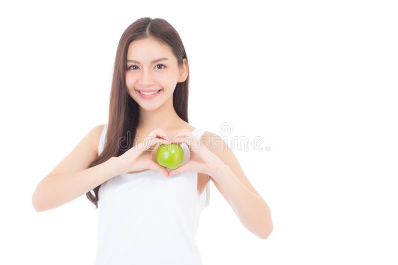 Beautiful of portrait young asian woman smile and holding green apple fruit. With heart shape wellness and healthy isolated on white background stock images