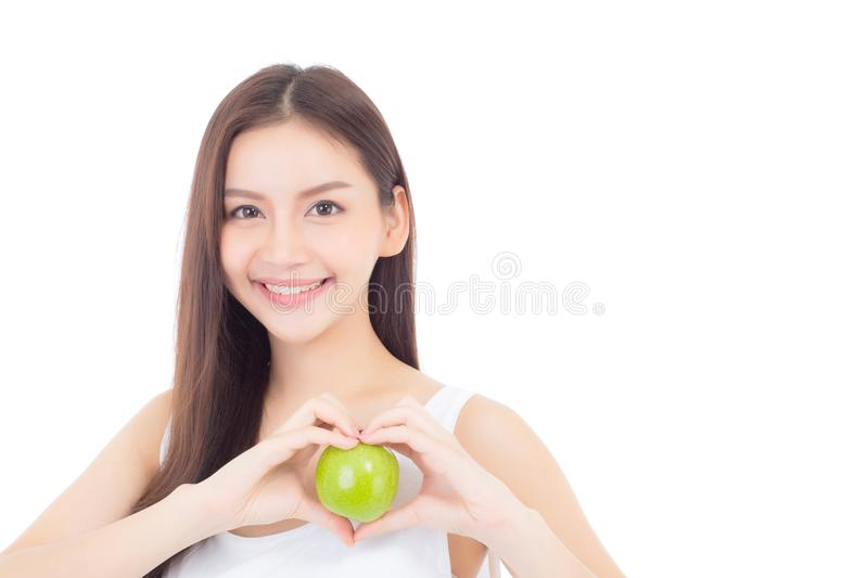 Beautiful of portrait young asian woman smile and holding green apple fruit with heart shape. Wellness and healthy on white background royalty free stock images