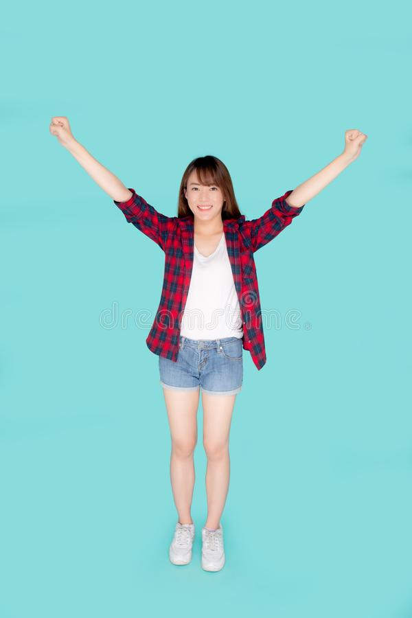 Beautiful portrait young asian woman smiling confident and excited summer holiday isolated blue background royalty free stock image