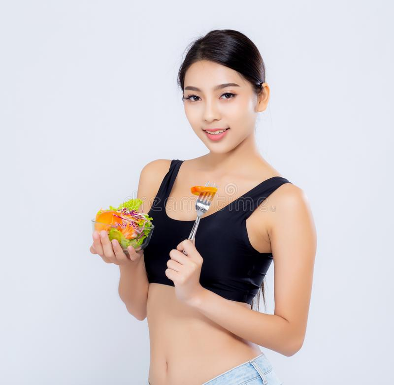 Beautiful portrait young asian woman smiling holding salad vegetable food isolated on white background, girl diet eating. Vegetarian for healthy, health care or stock photo