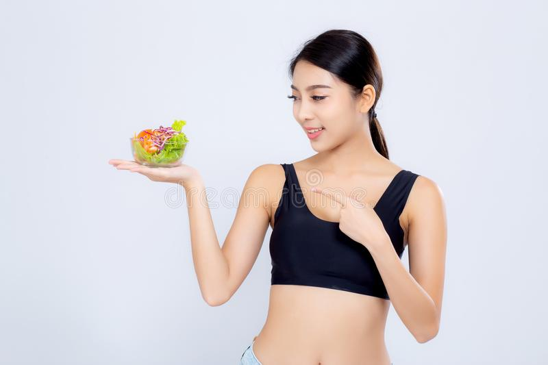 Beautiful portrait young asian woman smiling holding salad vegetable food isolated on white background stock photography