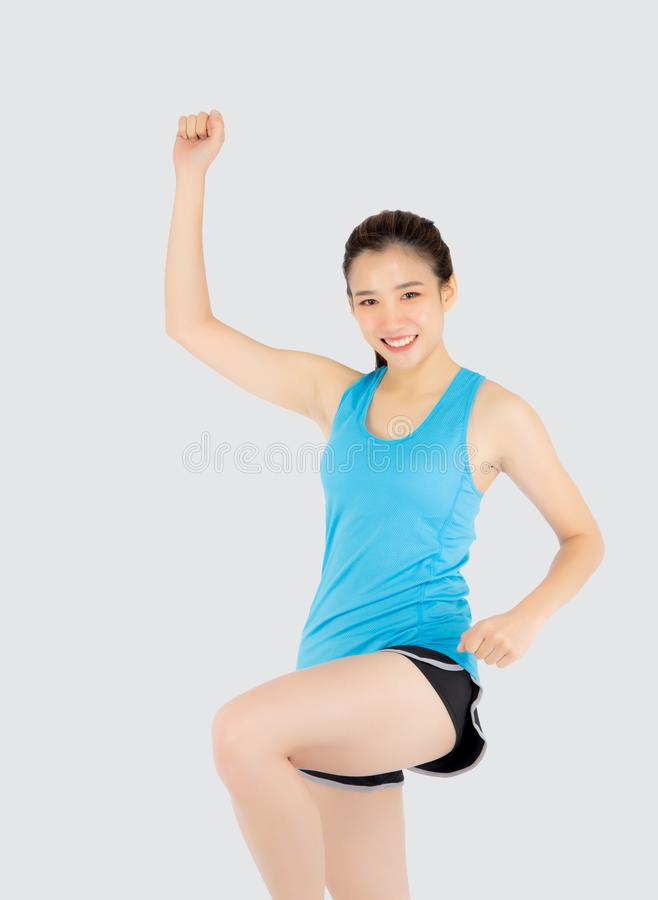 Beautiful portrait young asian woman in sport clothes cheerful with satisfied and confident  on white background. Asia girl have shape and wellness, exercise stock images