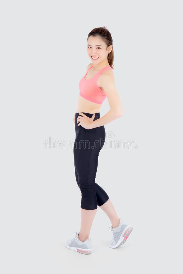 Beautiful portrait young asian woman in sport clothes with satisfied and confident isolated on white background. Asia girl cheerful have shape and wellness stock photo
