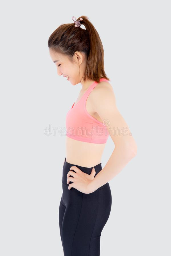 Beautiful portrait young asian woman in sport with satisfied and confident isolated on white background. Asia girl cheerful have shape and wellness, exercise stock image