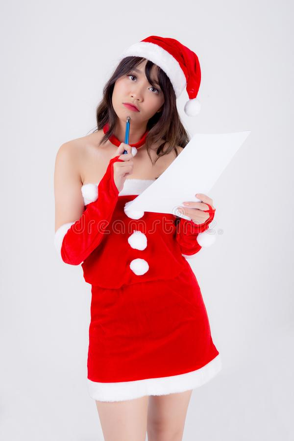 Beautiful portrait young asian woman thinking and writing notepad in xmas day isolated on white background stock photos