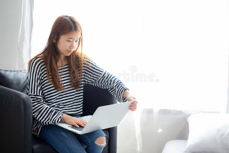 Beautiful of portrait young asian woman using laptop computer f stock photography