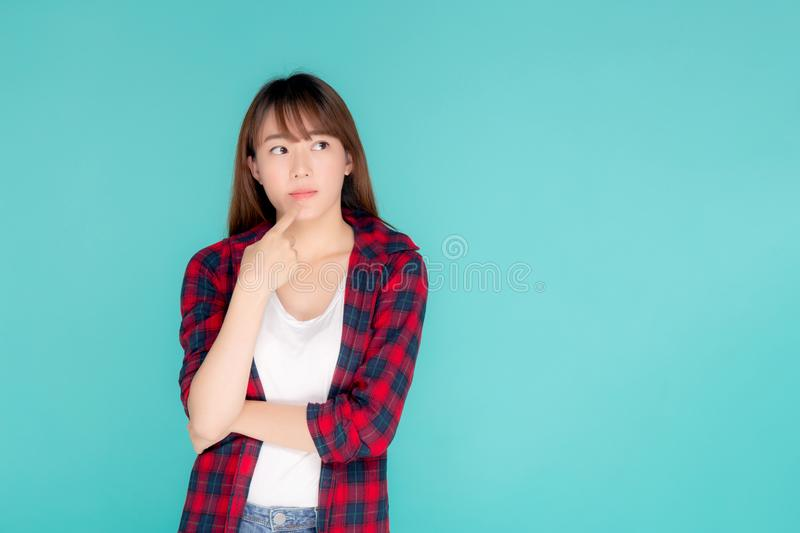 Beautiful portrait young asian woman wear clothes fashion travel thinking idea and enjoy summer holiday isolated royalty free stock image