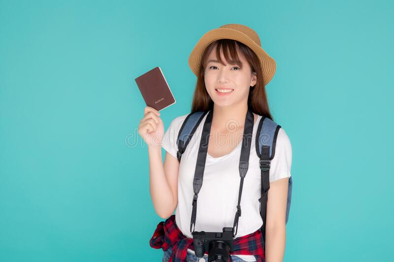 Beautiful portrait young asian woman wear hat smile confident holding passport and camera with travel summer trip stock image