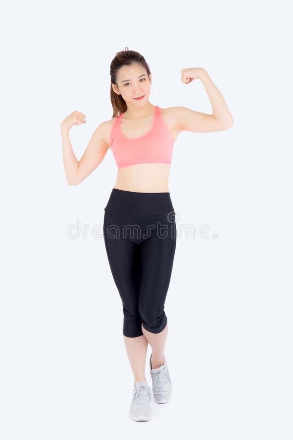 Beautiful portrait young asian woman wear sport clothes strong and muscle with health. Girl show biceps with exercise and workout for wellness isolated on stock images