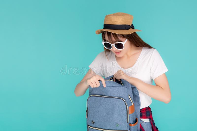 Beautiful portrait young asian woman wear sunglasses and hat smiling open backpack travel summer trip stock photos