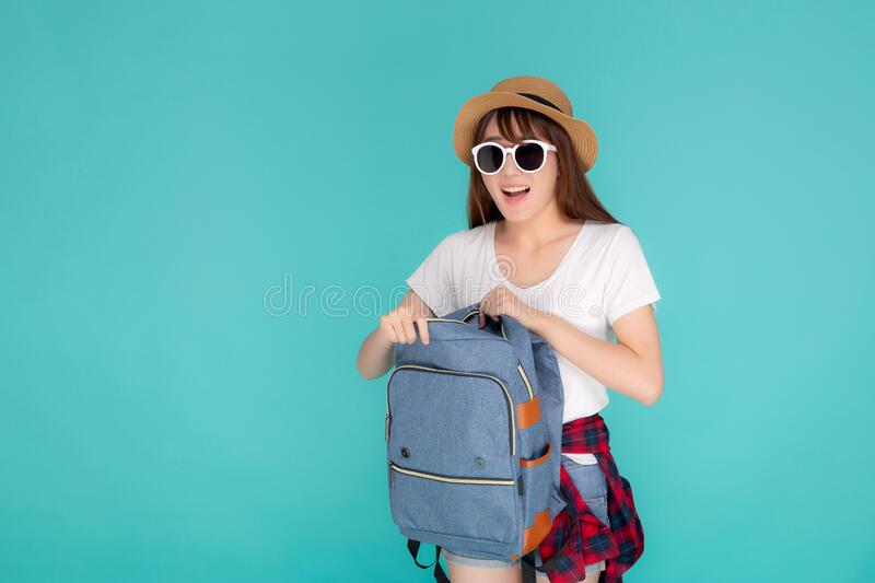Beautiful portrait young asian woman wear sunglasses and hat smiling open backpack travel summer trip holiday royalty free stock images