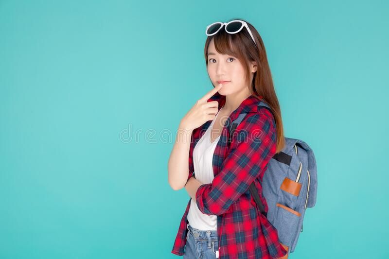 Beautiful portrait young asian woman wear sunglasses on head smile confident thinking and idea summer holiday royalty free stock photography