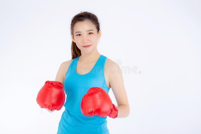 Beautiful portrait young asian woman wearing red boxing gloves with strength and strength isolated on white background, girl stock photography