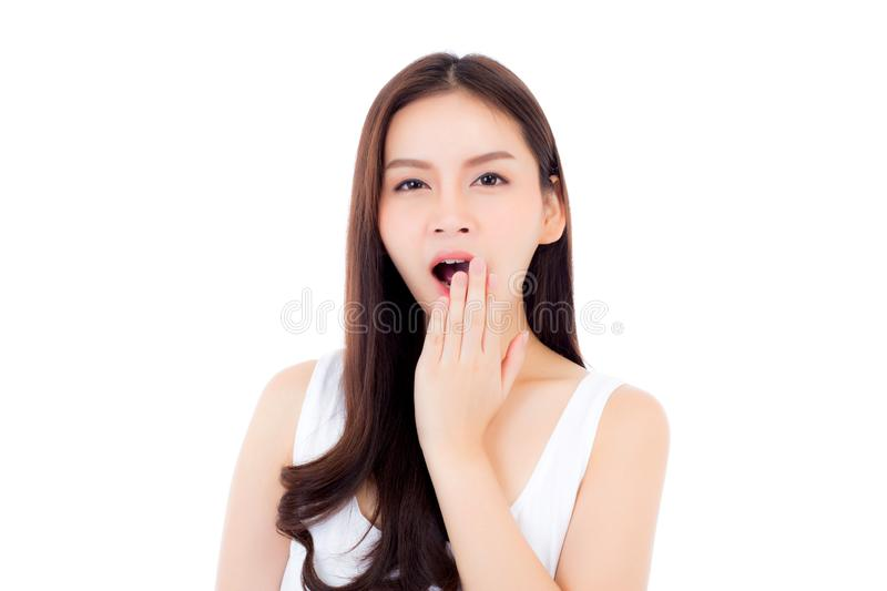 Beautiful portrait young asian woman yawn want resting with sleepy isolated on white background, girl wake up with tired and bore royalty free stock image