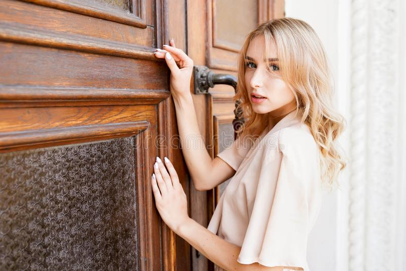 Beautiful portrait of Young blonde Woman Outdoor. Enjoy Sunny day royalty free stock images