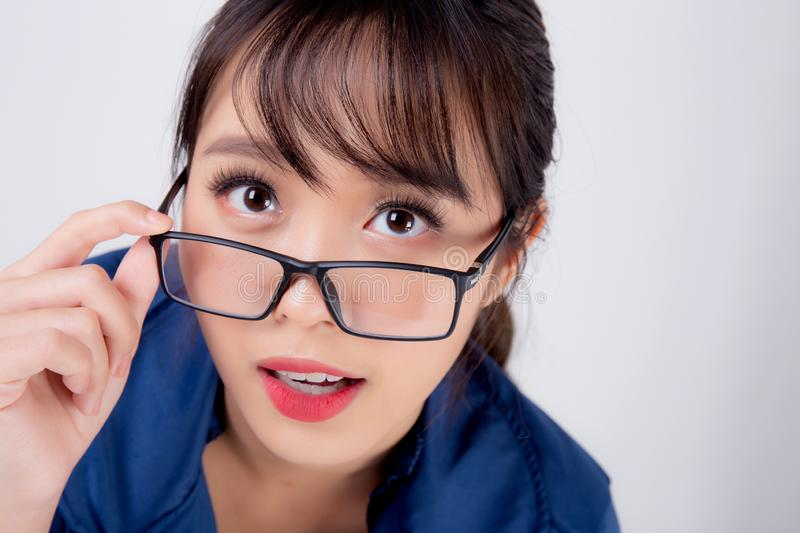 Beautiful portrait young business asian woman standing wearing glasses surprise and excited success isolated on white background royalty free stock photography
