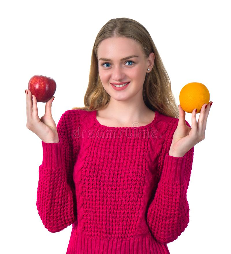 Beautiful portrait of young woman with orange and apple. Healthy royalty free stock image