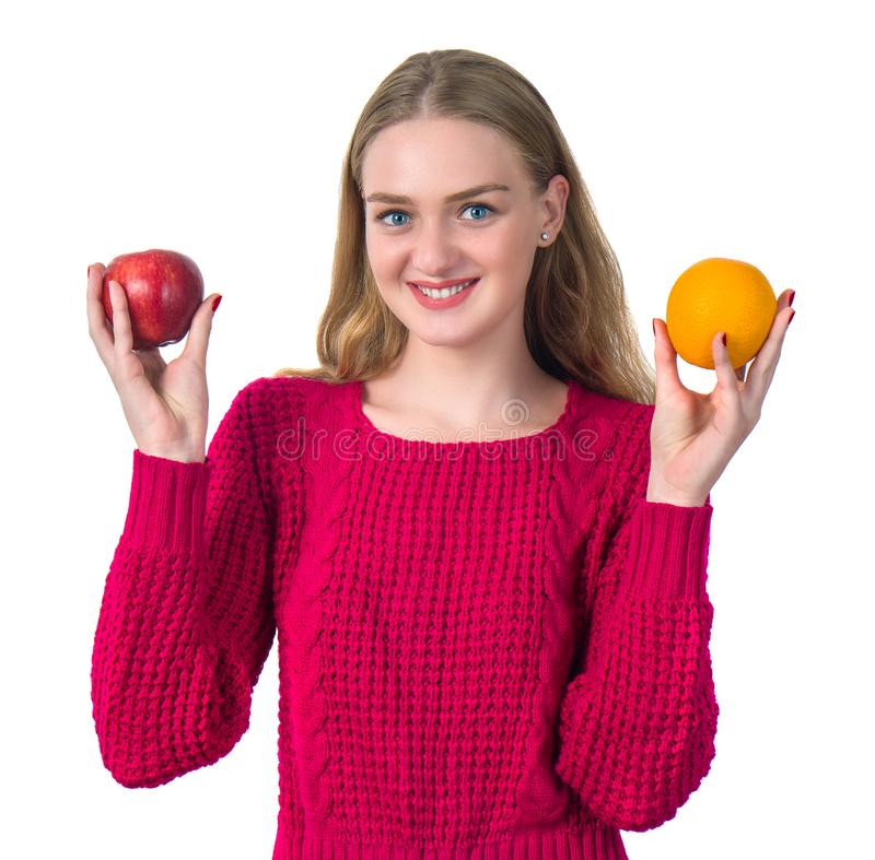 Beautiful portrait of young woman with orange and apple. Healthy royalty free stock photos