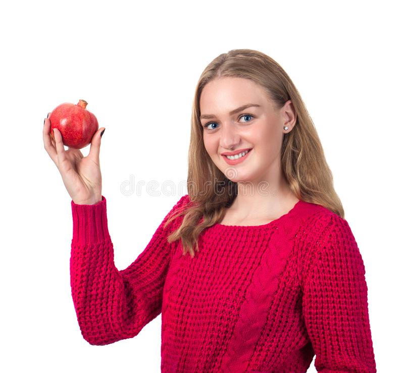 Beautiful portrait of young woman with pomegranate. Healthy food stock photo